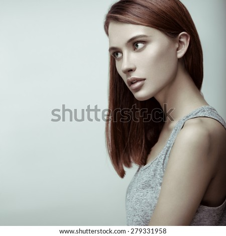 Beauty portrait of young sexy red-haired model with long straight hair. Professional nude makeup. - stock photo