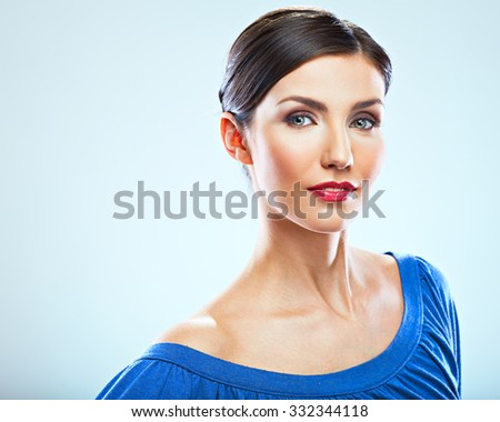 Beauty portrait of young sexy woman. Studio isolated. Blue dress with big decollete.