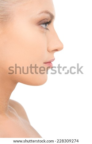 Beauty portrait of young smiling girl in profile with blond hair. portrait of pretty nude blond woman looking away - stock photo