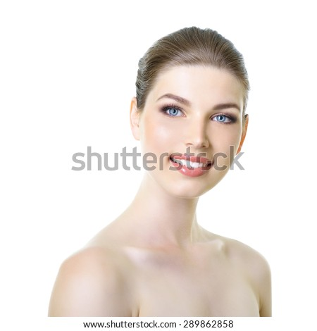 Beauty portrait of young smiling woman with beautiful healthy face, studio shot of attractive girl over white background