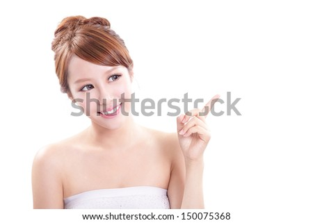 Beauty portrait of young woman showing beauty product / empty copy space with finger pointing, asian beauty - stock photo
