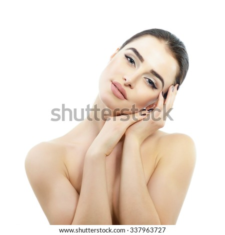 Beauty portrait of young woman touching her beautiful healthy face with her hands, studio shot of attractive girl over white background