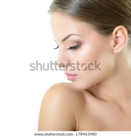 Beauty portrait of young woman with beautiful healthy face in profile, studio shot of attractive girl over on white background