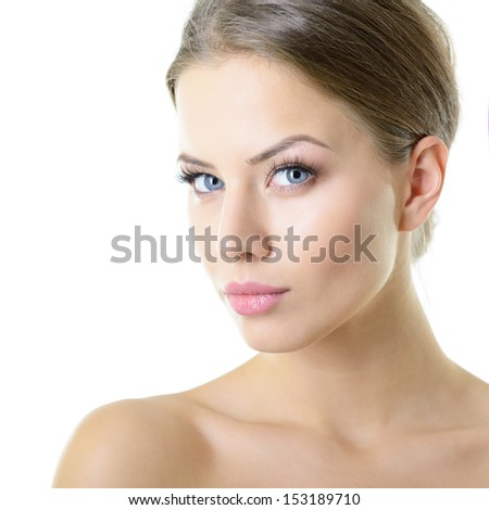 Beauty portrait of young woman with beautiful healthy face looking at camera, studio shot of attractive girl over on white background - stock photo
