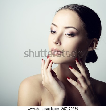 Beauty portrait of young woman with beautiful healthy face, studio shot of attractive girl, image toned - stock photo