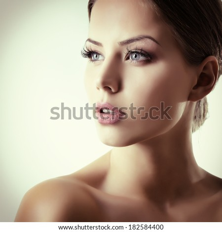 Beauty portrait of young woman with beautiful healthy face, studio shot of attractive girl, toned - stock photo