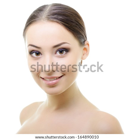 Beauty portrait of young woman with beautiful healthy face with nice day makeup looking at camera, studio shot of attractive girl over white background