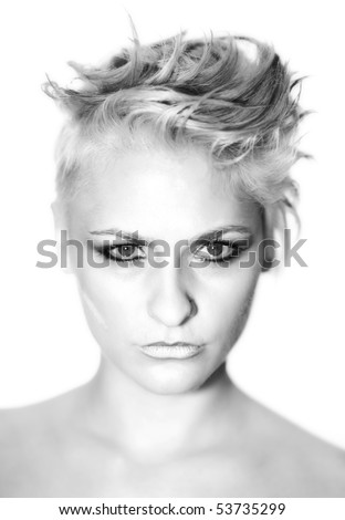 beauty portrait of young woman with strong make up and interesting hair style in black and white