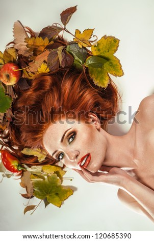 Beauty portrait with autumn leaves