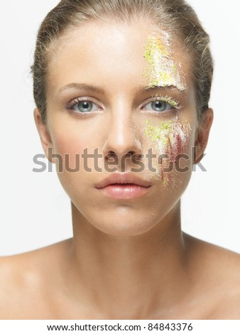 beauty portrait woman loose colored powders face - stock photo