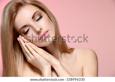 Beauty portrait woman with eyes closed, sleeping. Sensual attractive pretty nude blonde girl dreaming on pink, shiny straight hair. People face closeup, makeup, copyspace - stock photo