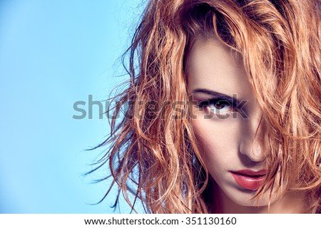 Beauty portrait woman with wet wavy hair. Playful sexy redhead model, natural makeup, fashion.Sensual attractive girl provocative looks, long eyelashes, copyspace, blue.People face closeup. Confidence - stock photo