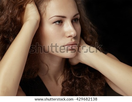 Beauty portrait young blonde woman in dark studio in beauty and lifestyle style