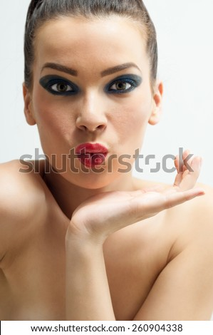 Beauty portrait young woman  holding her face between hands. She pouting her lips. Developed from RAW - stock photo