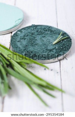 beauty product samples and lavender on white wooden table background