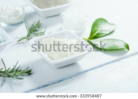 beauty products, cosmetic cream on white wooden table background