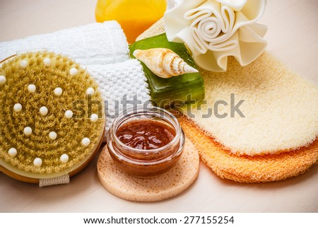 Beauty relaxation and body care. Closeup spa products on wooden table. - stock photo