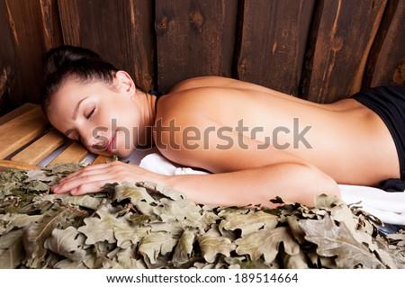 Beauty relaxing in bathhouse. Beautiful young woman relaxing in bathhouse - stock photo