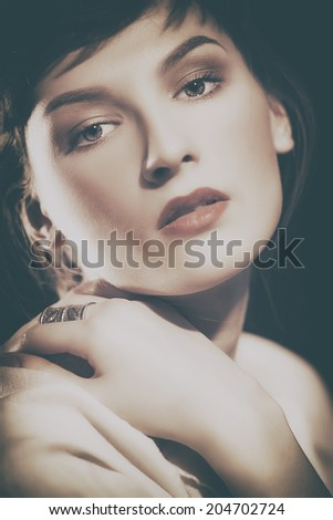 beauty. retro female portrait with faded colors - stock photo