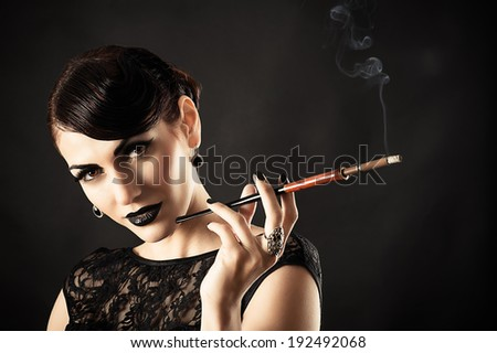 Beauty Retro Model with Black Makeup and Cigarette in hand