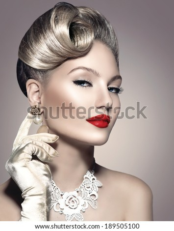 Beauty Retro Woman Portrait. Glamour Lady. Jewellery. Pearl Earrings. Vintage styled Girl with perfect make up and hairstyle. Luxury Accessories. Golden Jewelry - stock photo