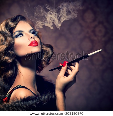 Beauty Retro Woman with Mouthpiece. Vintage Styled Beautiful Lady with cigarette. Smoking Model Girl Portrait. Hairstyle and Make up. Old Fashioned Makeup and Finger Wave Hairstyle. 20's or 30's style - stock photo