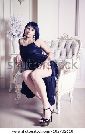 Beauty rich luxury woman on the armchair