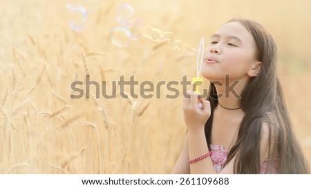 Beauty Romantic Girl on a wheat field in the sunlight - stock photo