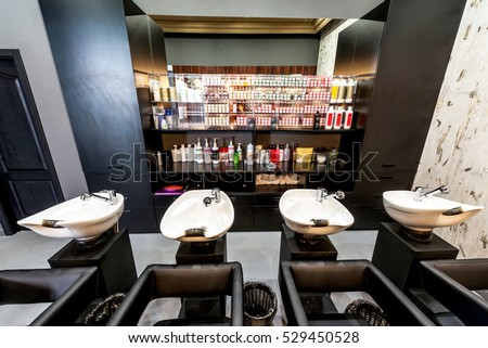 Beauty salon interior - a row of hair washing sinks