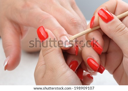 beauty salon, manicure applying, cleaning the cuticles