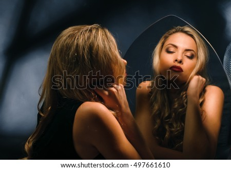 beauty Seductive girl about the mirror