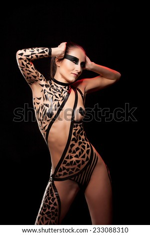 Beauty sexy girl in black tape dress, studio posed, bdsm