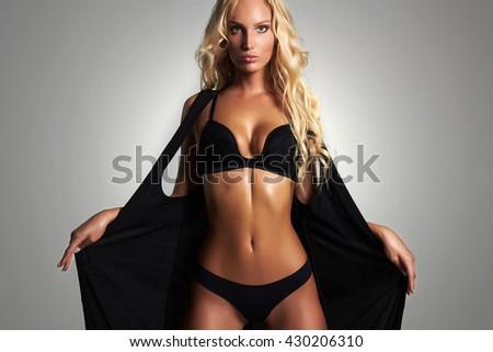 beauty sexy woman in black lingerie, looking at camera. beautiful blonde model girl in underwear. tan skin - stock photo