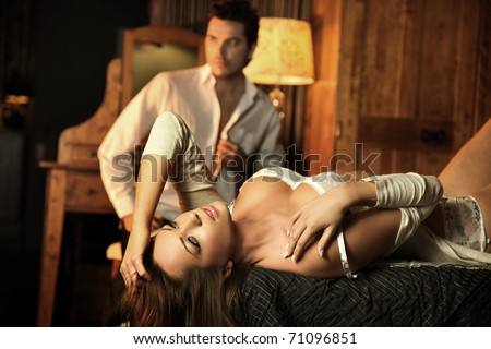 Beauty sexy woman lying on the bed - stock photo