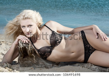 beauty sexy woman on beach in bikini