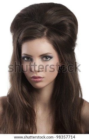 beauty shot close up portrait  of a alluring girl with creative hairstyle and strong eyes expression - stock photo
