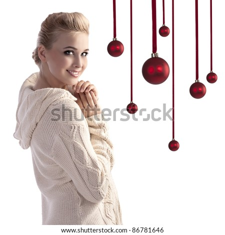 beauty shot of a beautiful smiling girl wearing a white woolen sweater and an up-do - stock photo