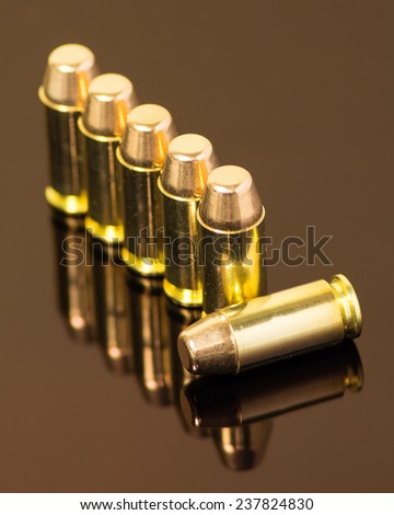 Beauty shot of .40 mm ammunition with one laying down. - stock photo