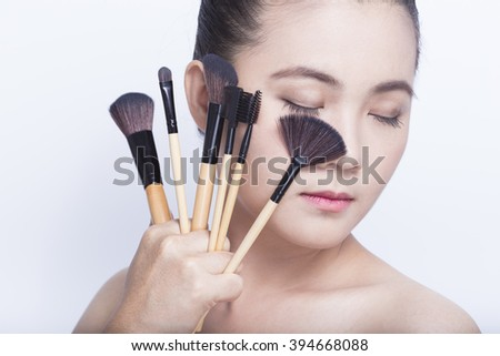 Beauty shot of woman holding the makeup brush