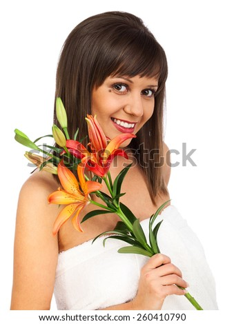 Beauty shot of young caucasian woman with flower in her hand, isolated on white