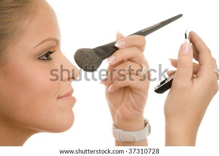 Beauty shot, young woman doing makeup, isolated on white background.