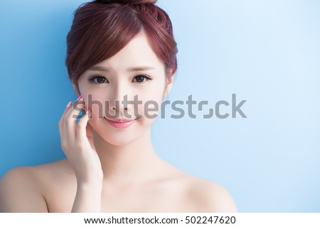 beauty  skin care woman smile to you isolated on bluebackground, asian