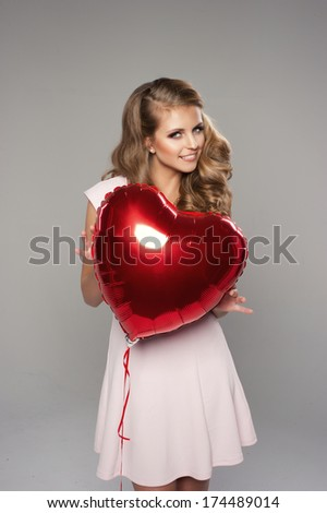 Beauty smile woman with balloon  - stock photo