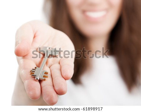 Beauty smiling female human hand holding house key - stock photo