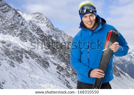 Beauty smiling man in winter in mountains