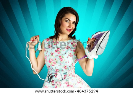 Beauty smiling pin-up girl with iron on blue background