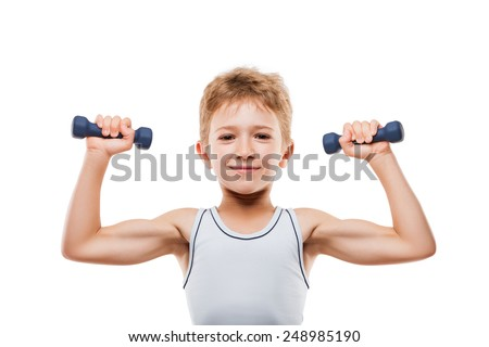 Beauty smiling sport child boy with strong biceps muscles hand holding exercising fitness dumbbell weights white isolated