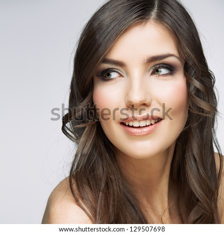 Beauty smiling  woman face close up portrait. Female young model. Studio isolated . - stock photo