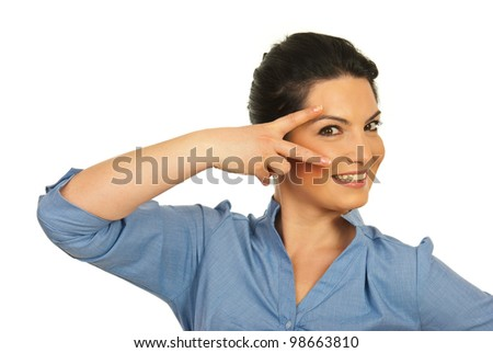 Beauty smiling woman showing two fingers in front of eye isolated on white background