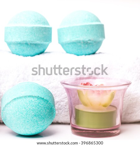 Beauty spa, bath bomb, aroma cosmetic soap with candles and towel. Natural aromatherapy ball for care, wellness, health, treatment, hygiene, relaxation. Relax bathroom. Object for luxury therapy - stock photo